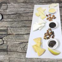 Assortment of cheeses with jams and fruit